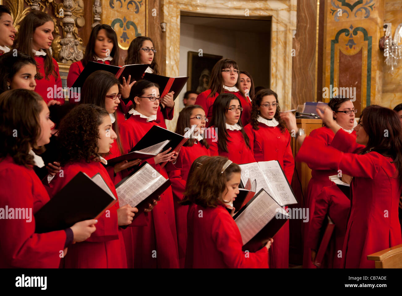 A choir singing during the High Mass at the stroke of midnight on Christmas Eve in the town of Xaghra in Gozo in - Stock Image
