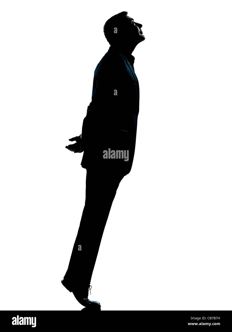 one  business man silhouette standing tiptoe looking up Full length in studio isolated on white background - Stock Image