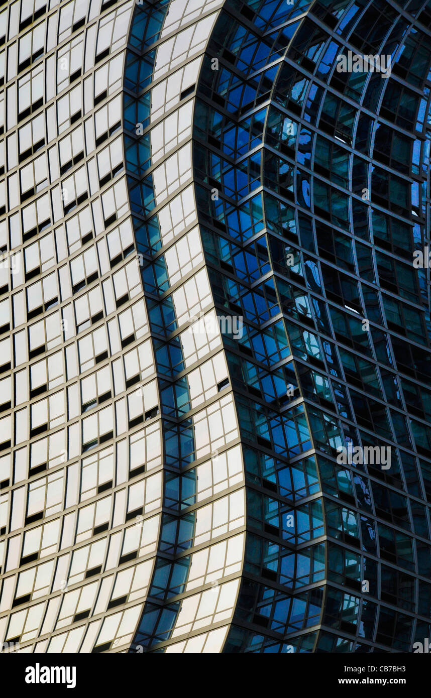 Twisted or warped glass and steel skyscraper structure - Stock Image