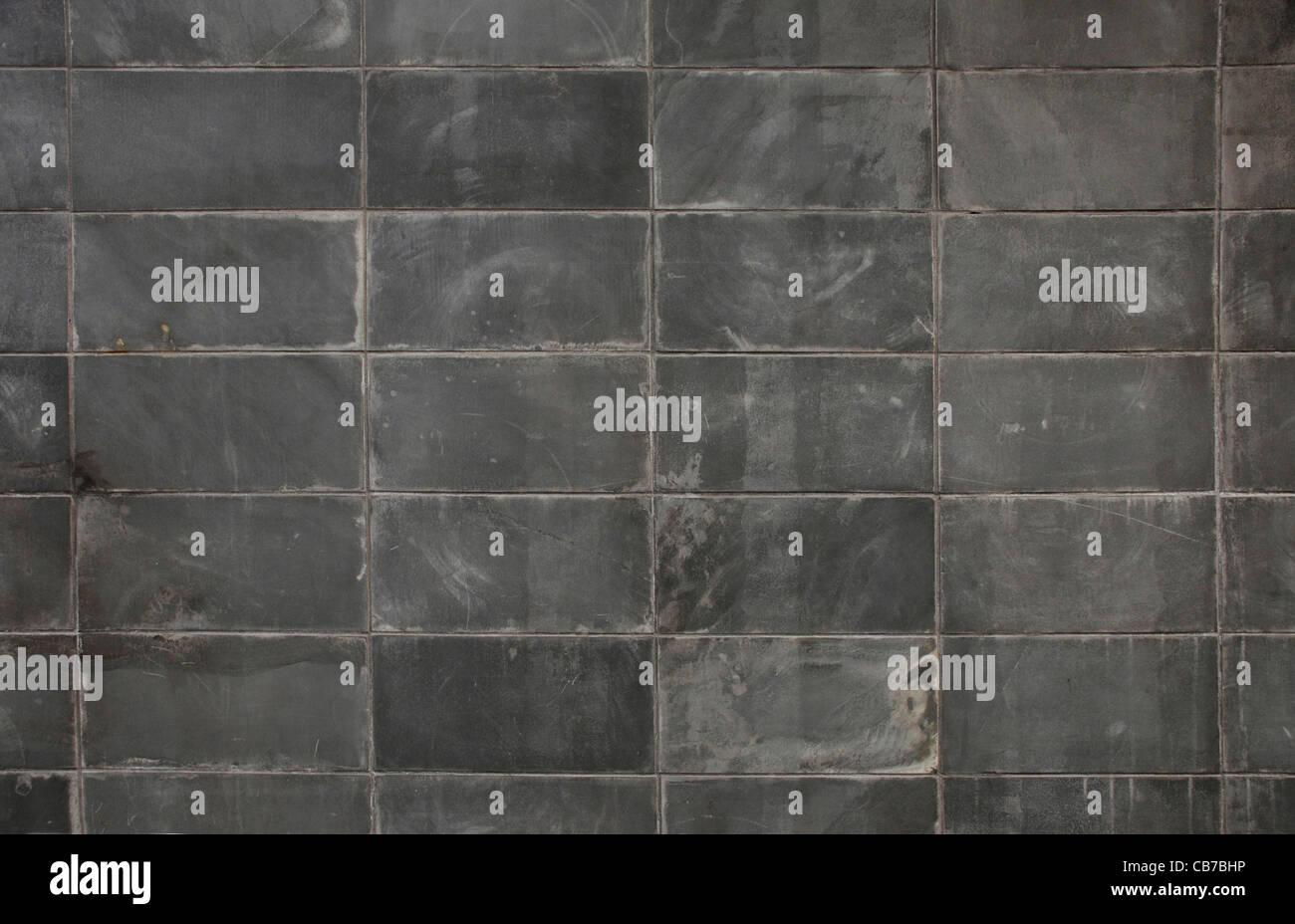 Dark gray block wall texture surface background - Stock Image