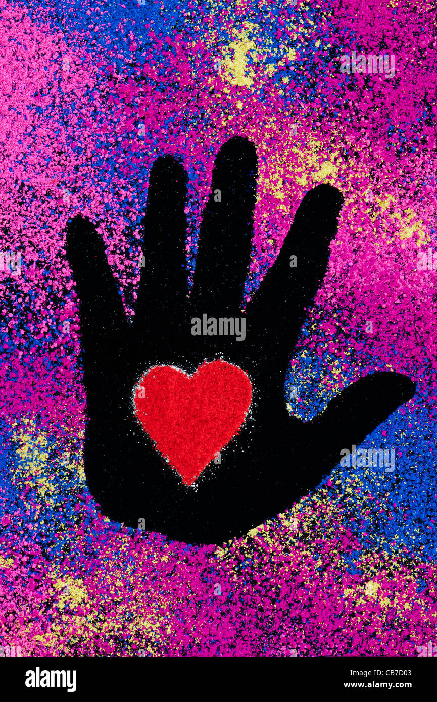 Childs hand prints with red heart shapes made with coloured powder on a black background - Stock Image