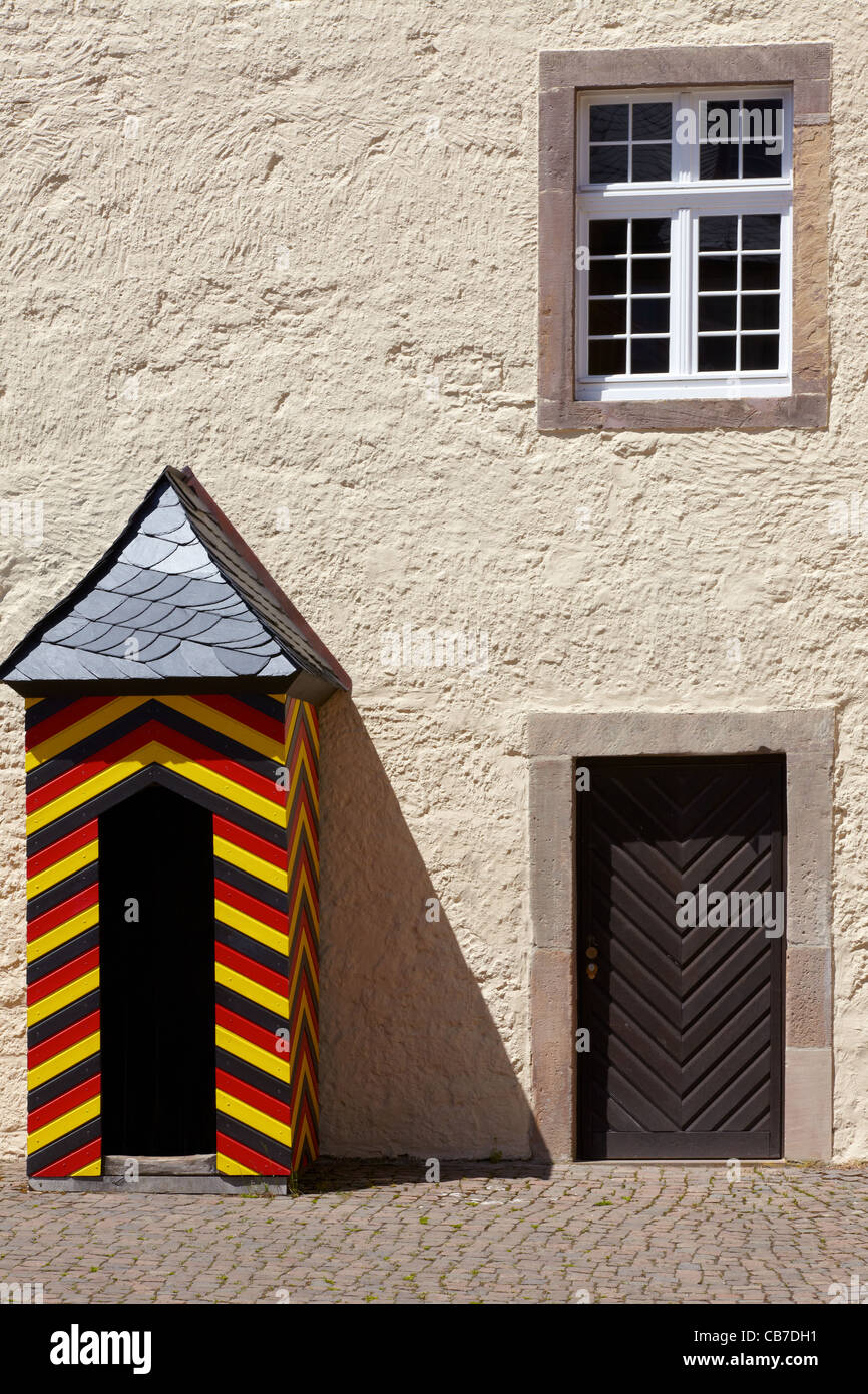 Small guard house painted in black, red and gold color on a forecourt of the castle Waldeck - Stock Image