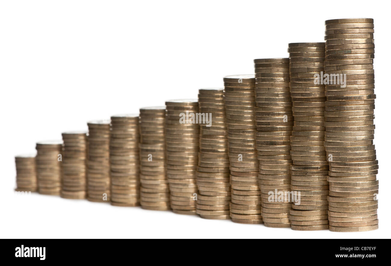 Stacks of 1 Euro Coins in front of white background - Stock Image