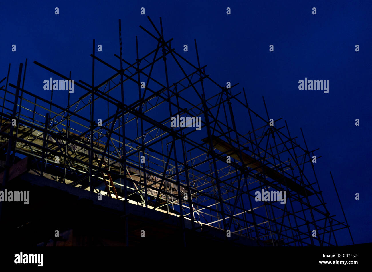 Scaffolding on a period building at night - Stock Image