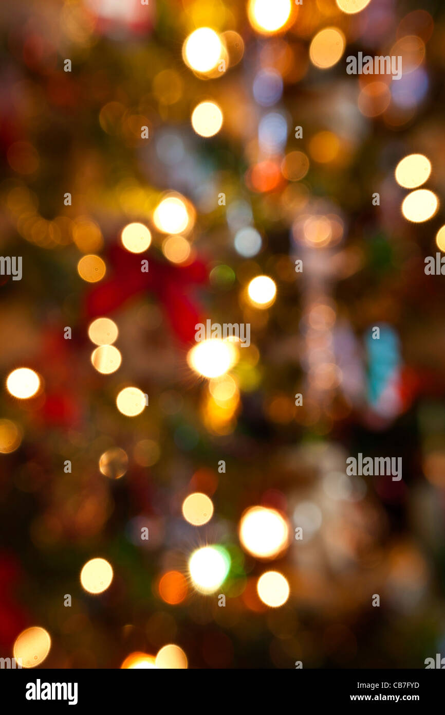 Christmas lights out of focus.upright format. - Stock Image