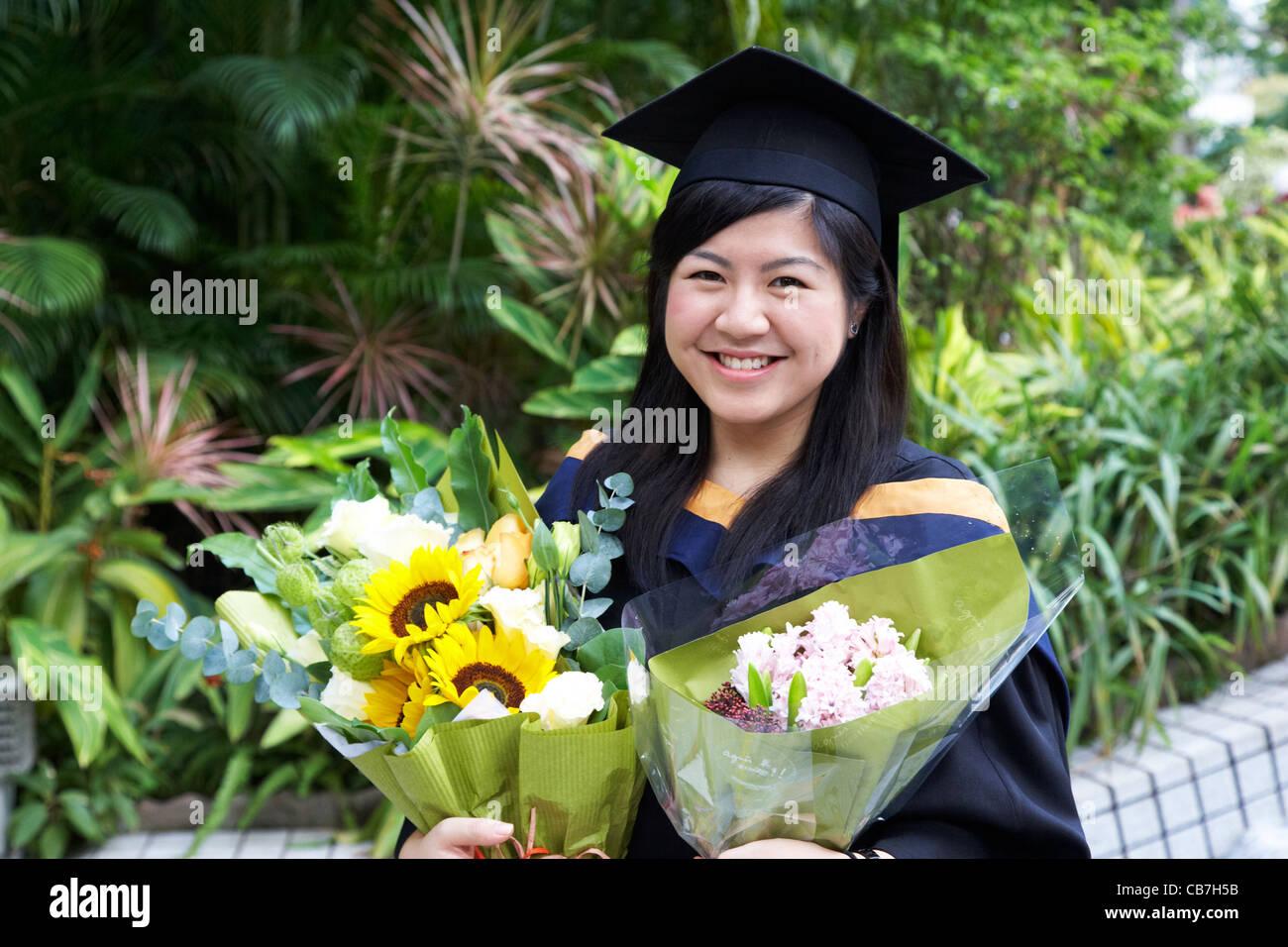chinese female university graduate on graduation day hong kong island, hksar, china - Stock Image
