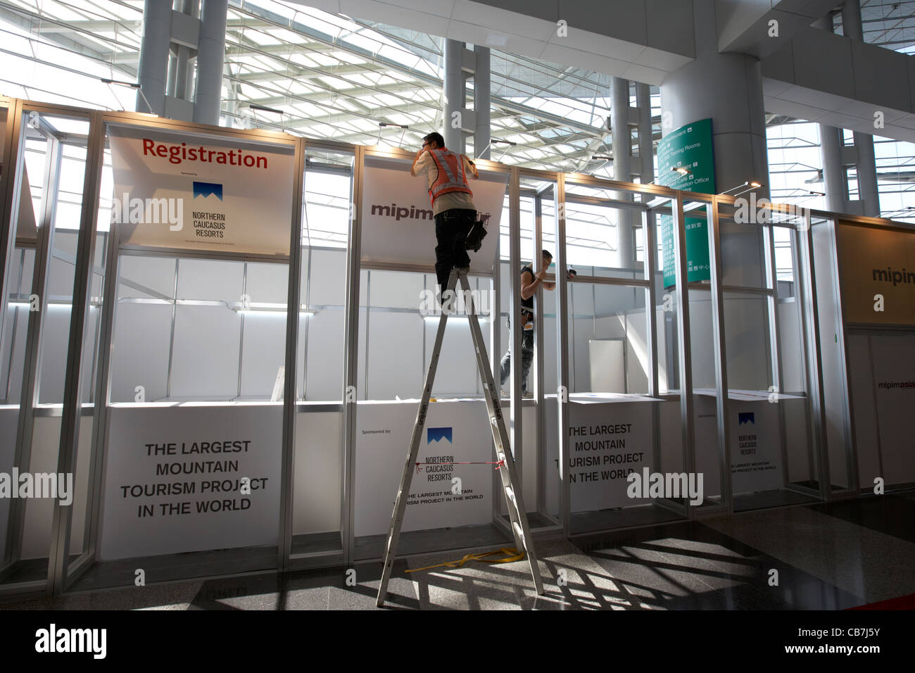 Exhibition Stand Design Hong Kong : Chinese workers erect an exhibition stand in the hong kong