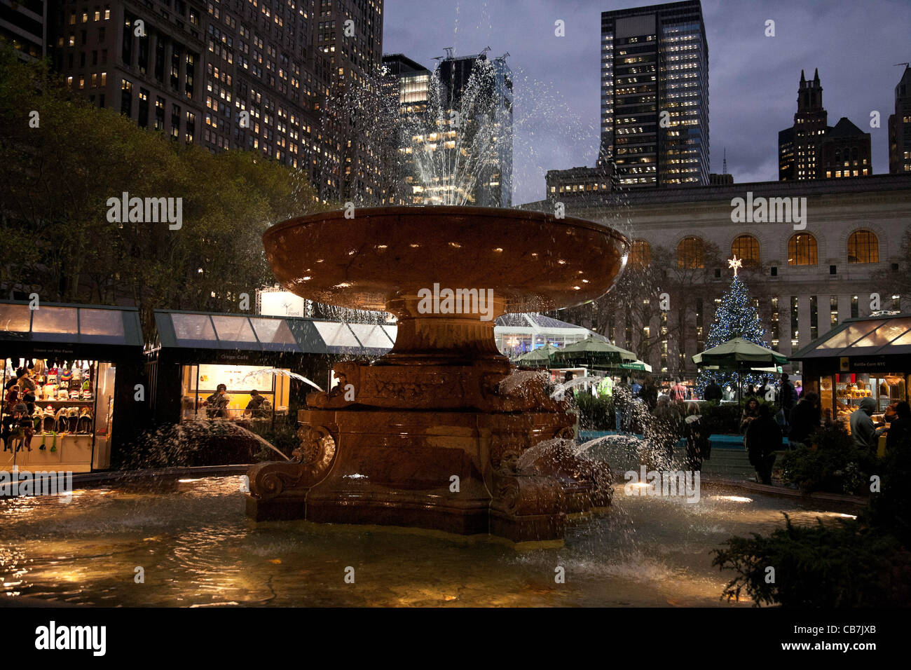 Fountain and Holiday Christmas Market in Bryant Park, NYC Stock ...