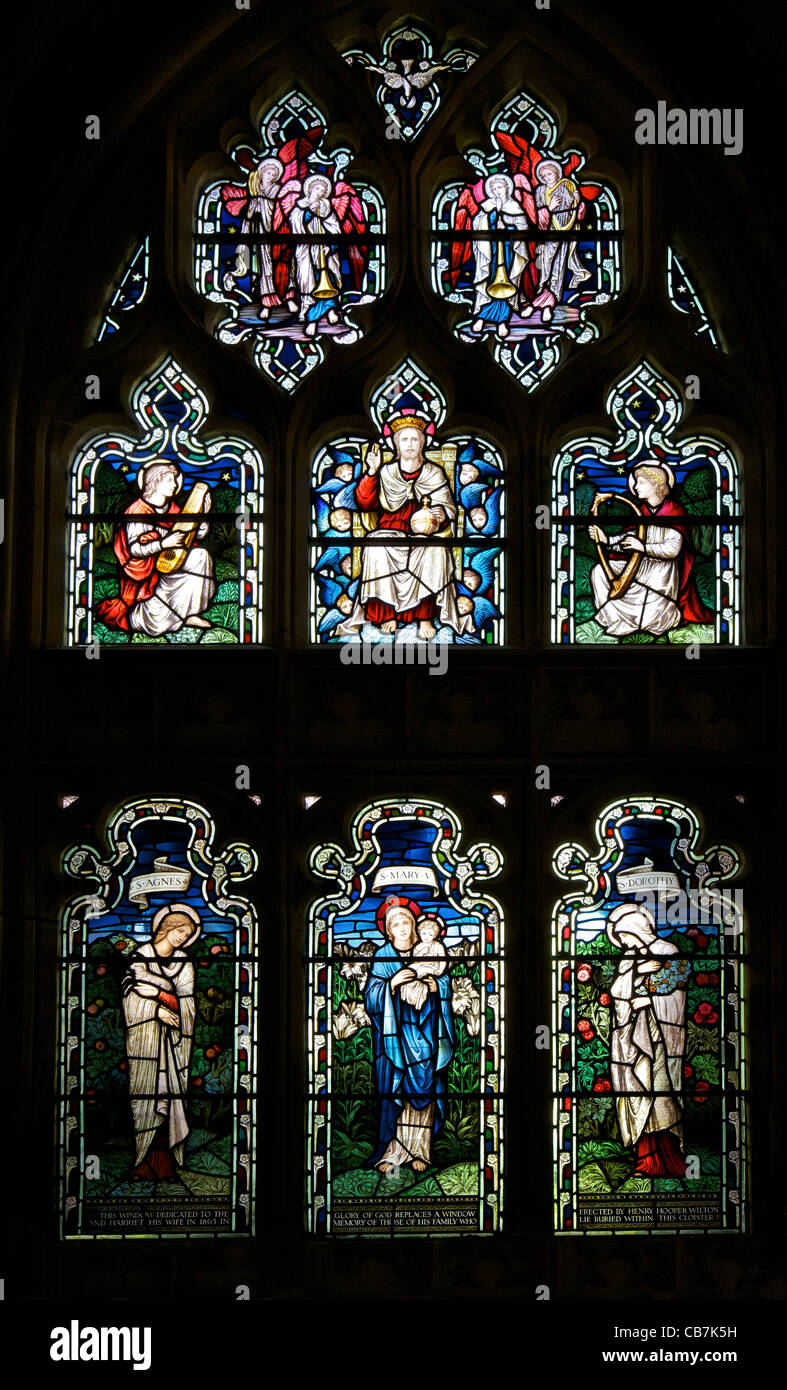 Stained glass window of St Agnes, St Mary and St Dorothy, by  Stephen Coyne, Morris & Co, 1924, cloisters, Gloucester - Stock Image
