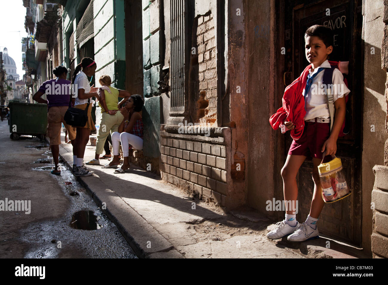 A primary student back from school, sunshine, Havana (La Habana), Cuba - Stock Image
