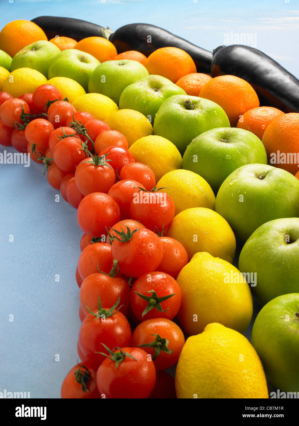 Tomatoes,lemons,green apples,Oranges, Aubergines, sprayed with water - Stock Image
