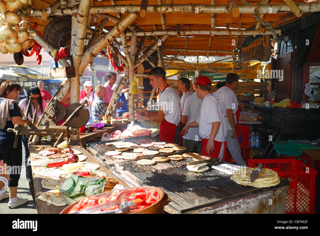Serbia August 2011 : 51st Guca International Trumpet Festival. A gastronomic stand. - Stock Image