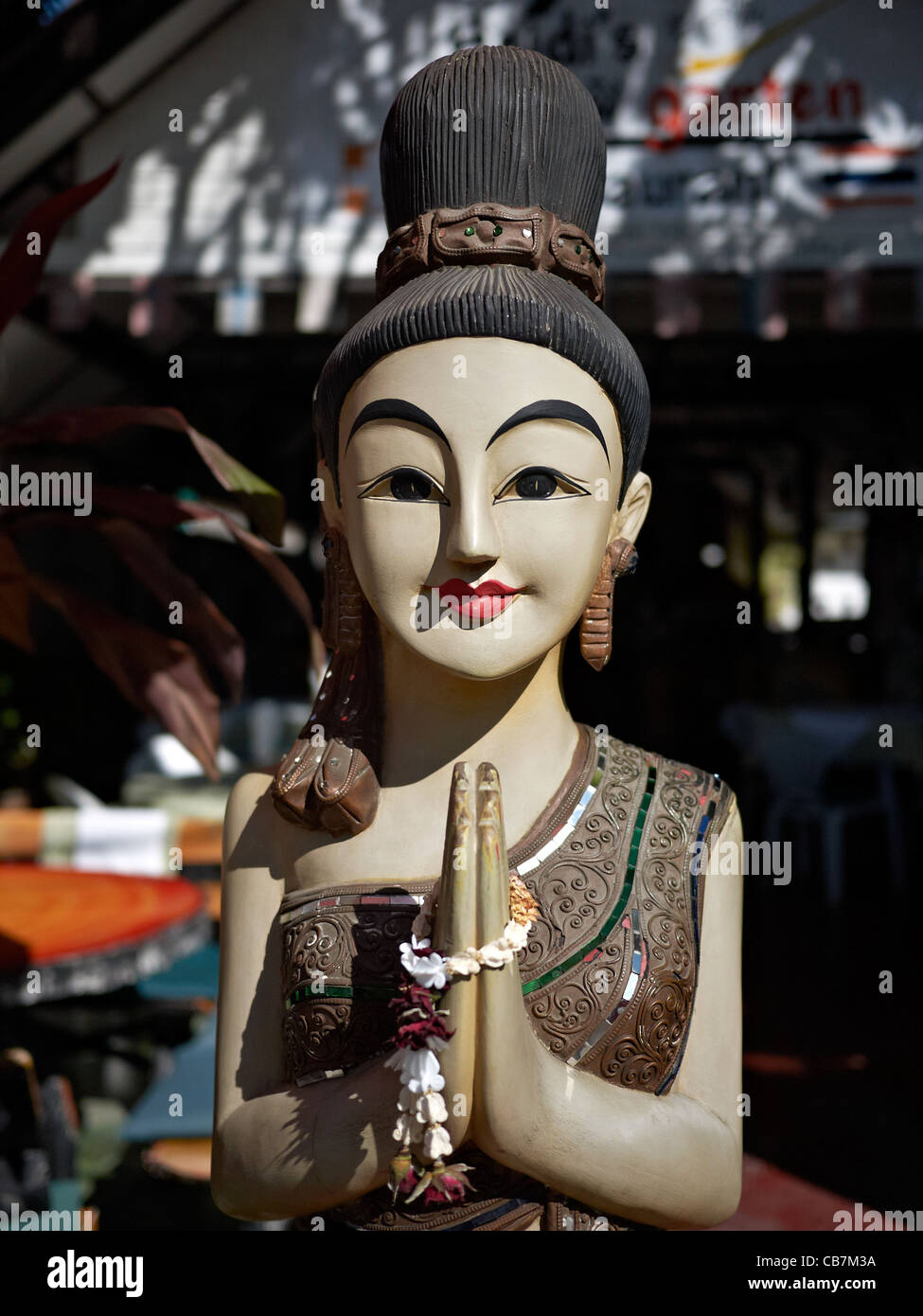 Thai statue carved in the traditional Thailand greeting known as a Wai. - Stock Image