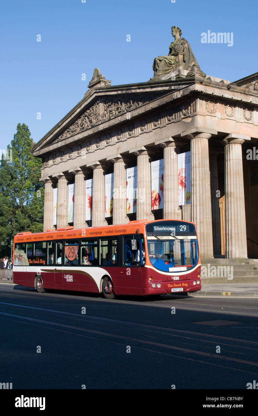 A single deck bus operated by Lothian Buses passes the Royal Scottish Academy Building in Princes Street, Edinburgh.Scotland - Stock Image