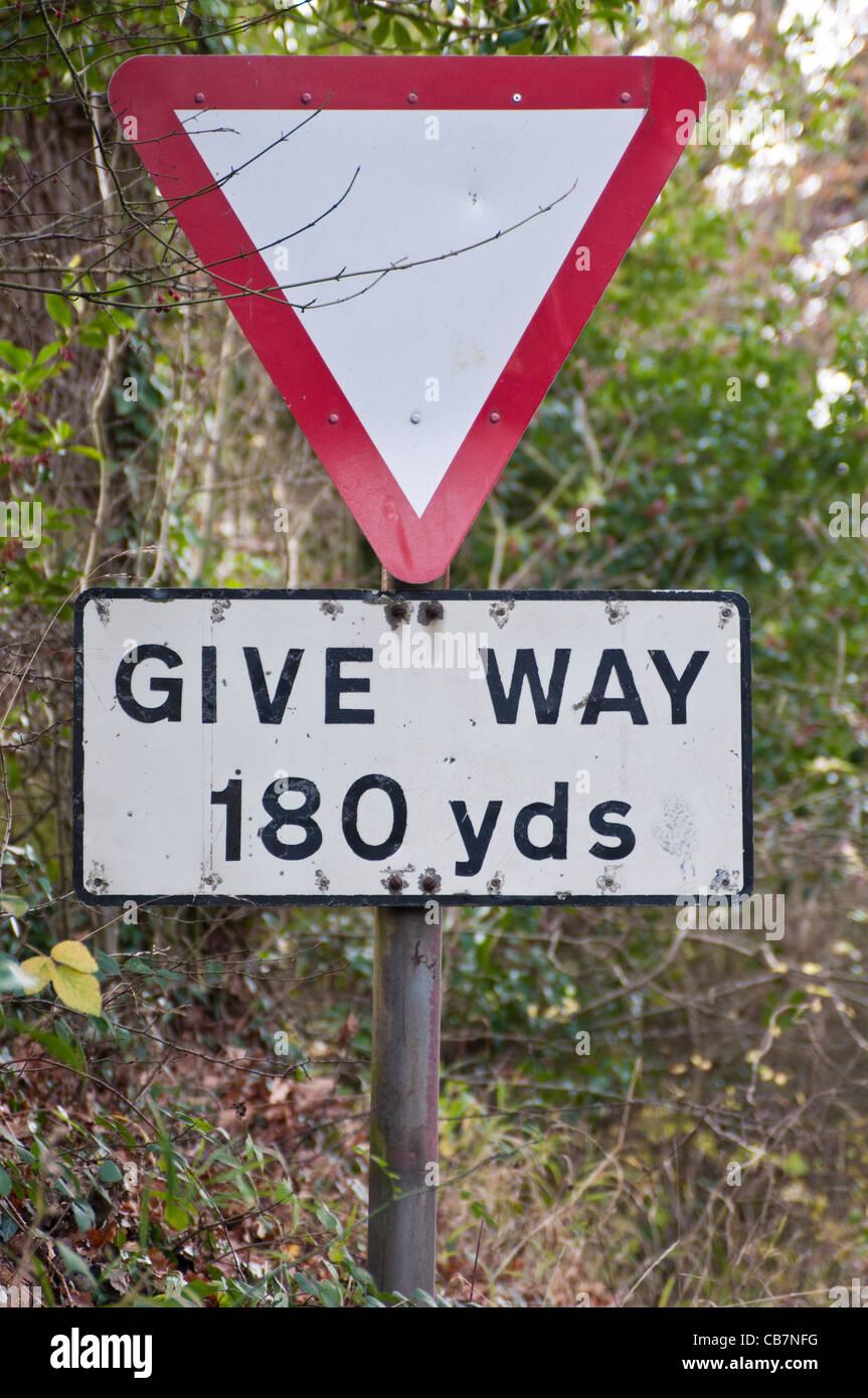 UK road sign 'Give way 180 yards'. - Stock Image
