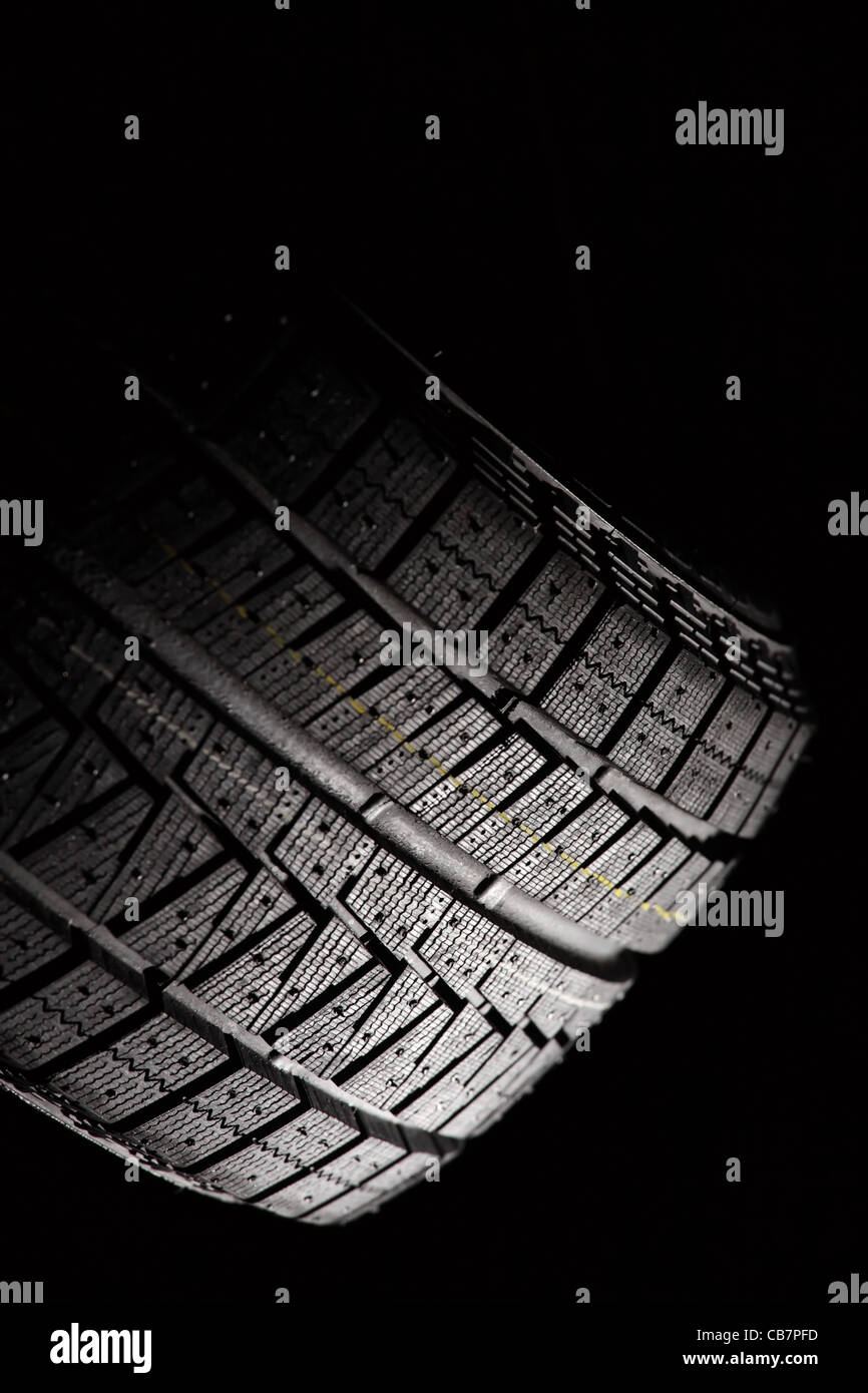 Part of unused car tyre. Vertical composition. - Stock Image