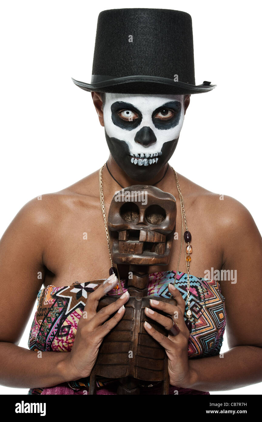 a female voodoo priestess with face paint Stock Photo