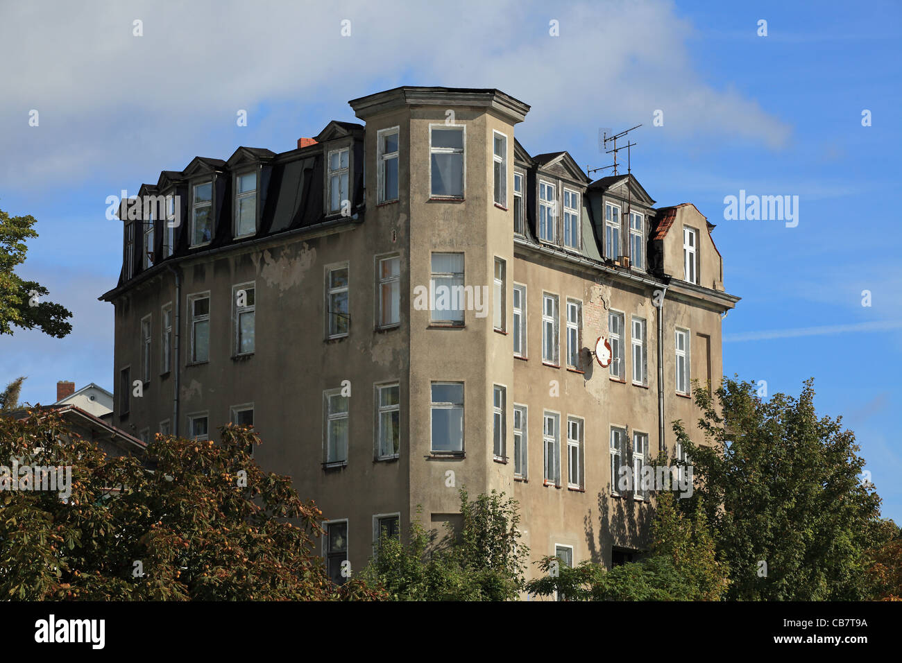 Old multistory residential house in need of renovation strongly - Stock Image