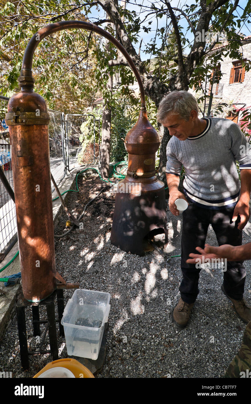 A copper still producing Tsipouro, a traditional Greek, spirit, at the Arna chestnut festival, Lakonia, Peloponnese, - Stock Image