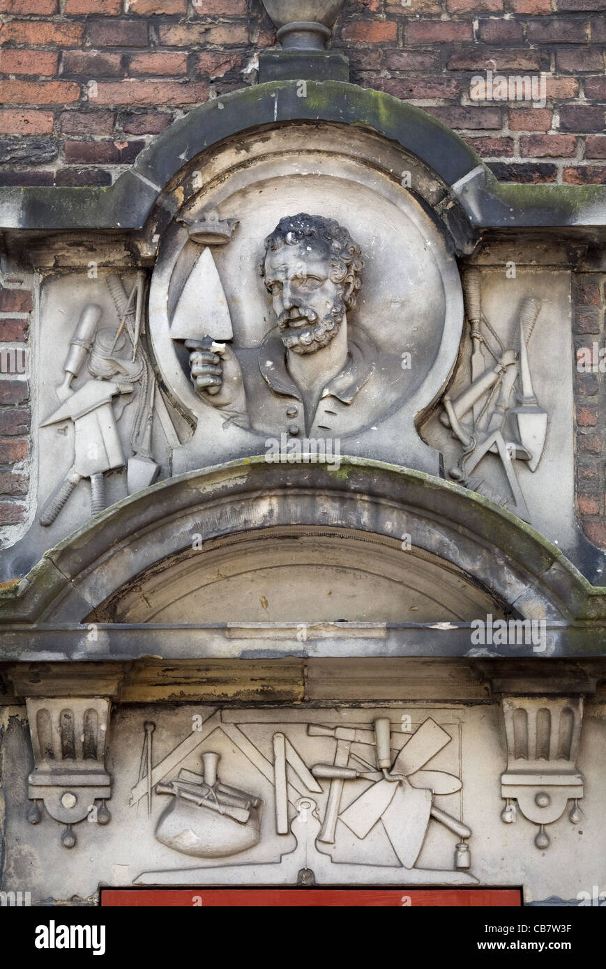 Mason imagery in a building timpani, Amsterdam, The Netherlands - Stock Image