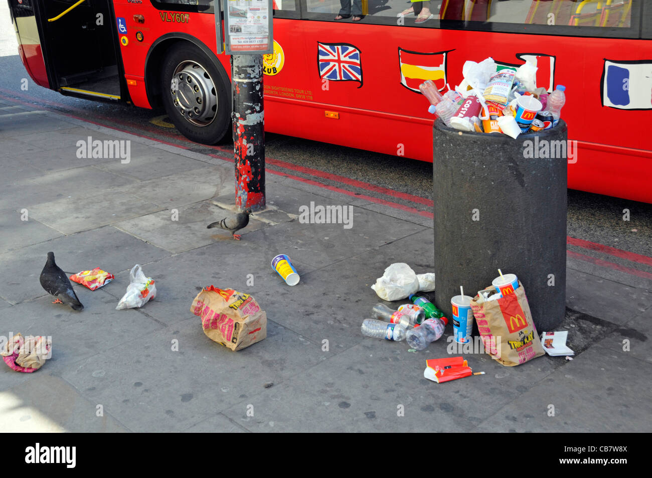 Waste management required to littering scene at street refuse bin full of rubbish garbage litter & trash spilling - Stock Image