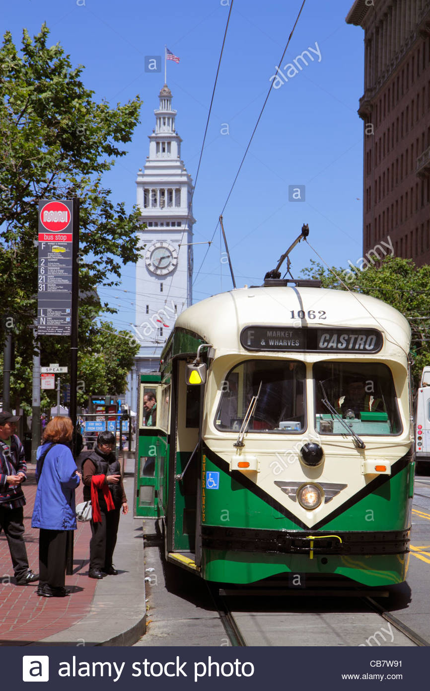 San Francisco California Market Street at Spear Street 101 The Embarcadero Ferry Building 1898 clock electric streetcar - Stock Image