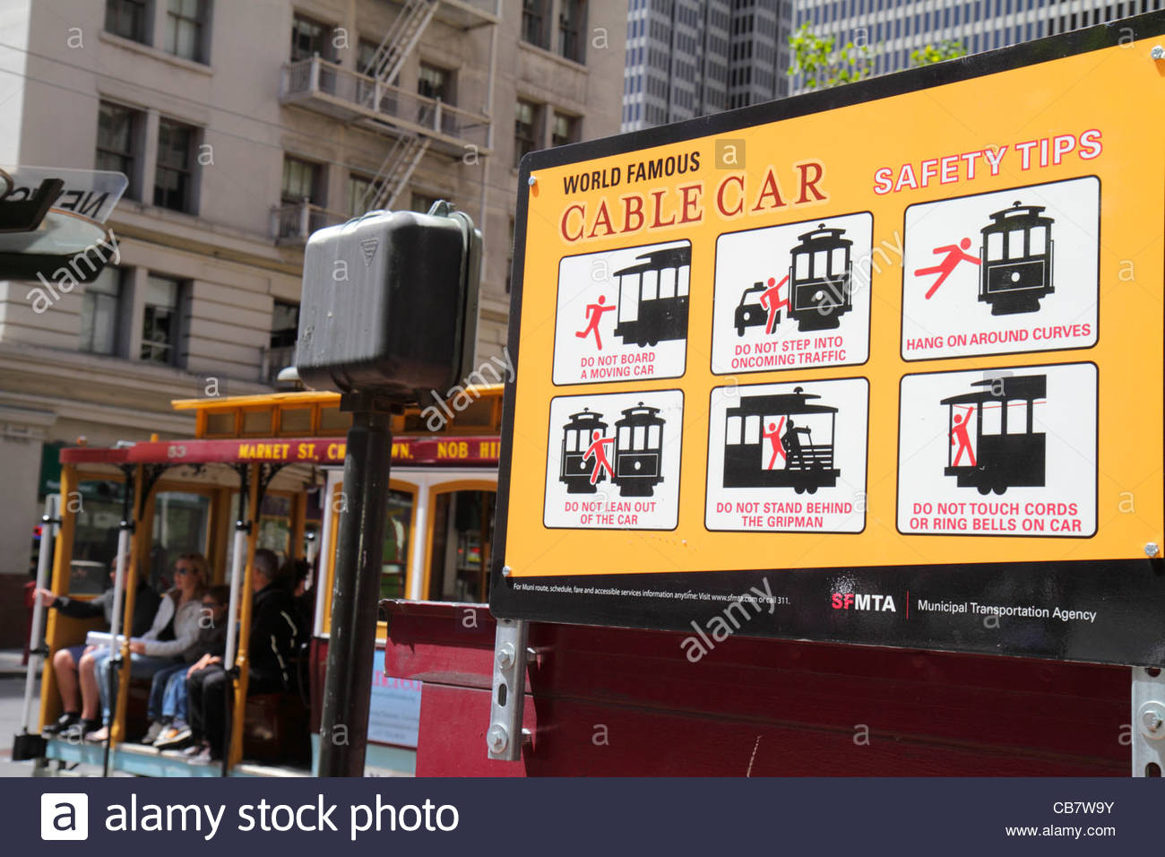 San Francisco California Market Street near Spear Street cable car safety tips sign MTA stop passenger information - Stock Image