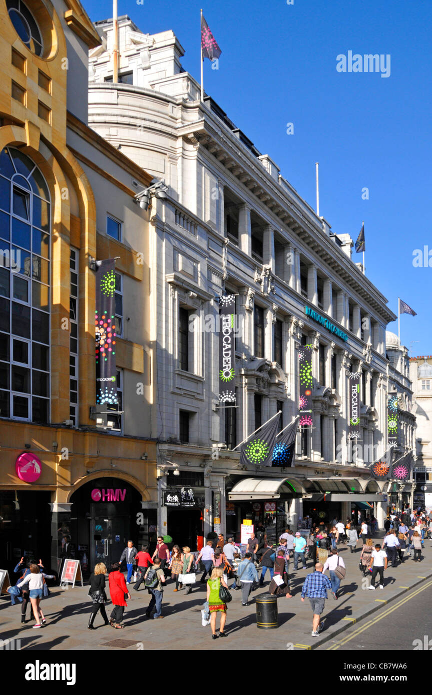 London street scene busy with people on pavement outside London Trocadero tourism shopping complex Coventry Street - Stock Image