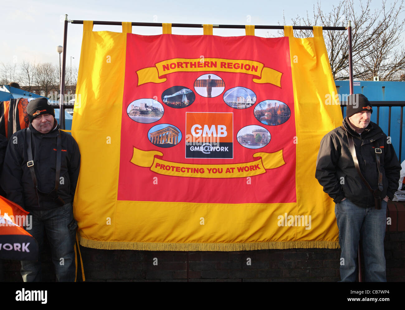 Two trades union members with a GMB banner , TUC day of action Gateshead, north east England, UK - Stock Image