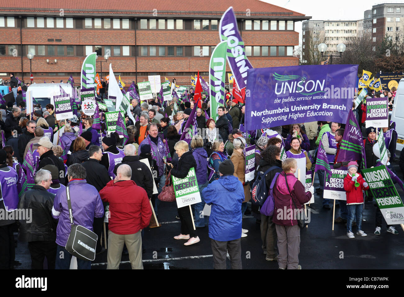 Gathering of trades union members with banners and flags, TUC day of action Gateshead, north east England, UK - Stock Image