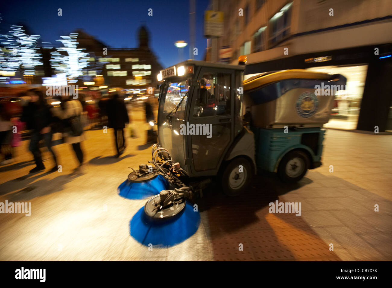 belfast city council street sweeper cleaning streets at night northern ireland uk deliberate panning motion blur - Stock Image