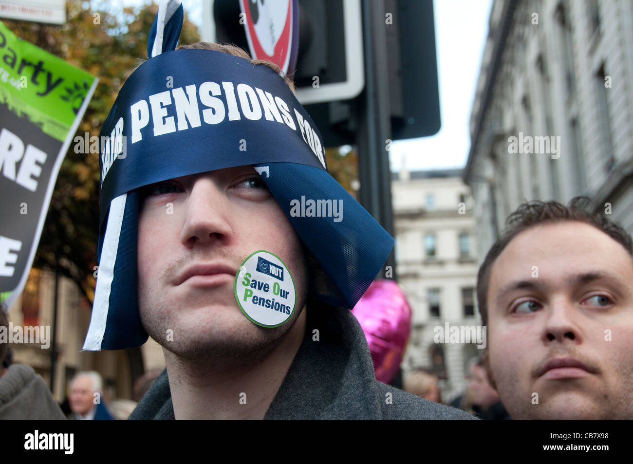A teacher has a sticker on his face saying 'NUT Save our pensions'. One day strike against pension cuts - Stock Image