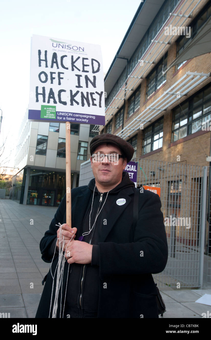Strike against pension cuts by public sector workers. Picket by Unison trade union member at Hackney Council who - Stock Image