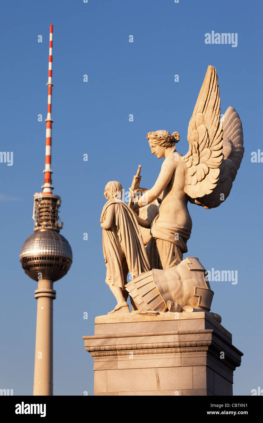 Classically themed sculpture on the Schlossbrucke in Berlin, Germany with the Fernsehturm in the background. - Stock Image