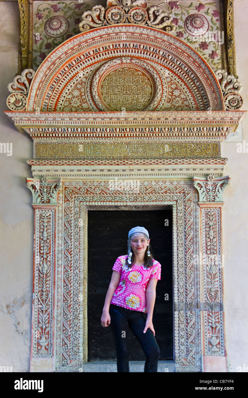 Girl at the door of Bakhchisaray Palace in Central Crimea, Ukraine - Stock Image