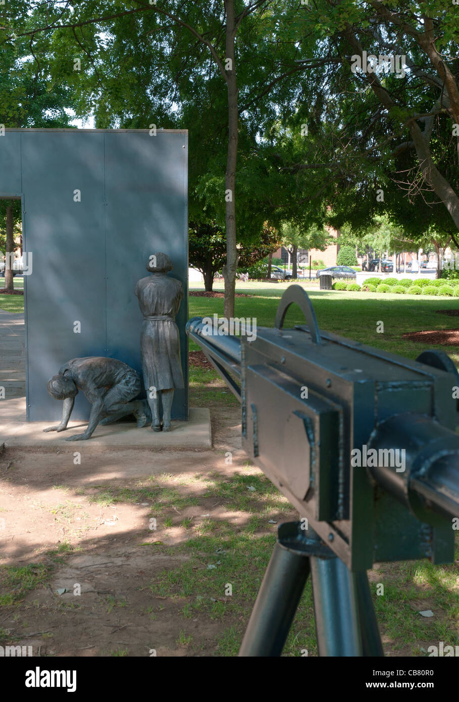Alabama, Birmingham, Kelly Ingram Park, memorial statue to civil rights movement, water cannon aimed at demonstrators - Stock Image