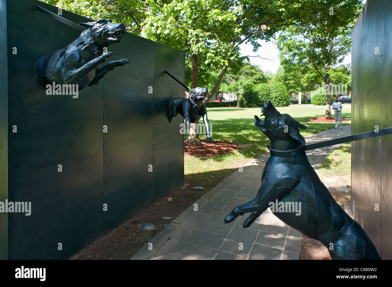 Alabama, Birmingham, Kelly Ingram Park, memorial statue to civil rights movement, police attack dogs - Stock Image
