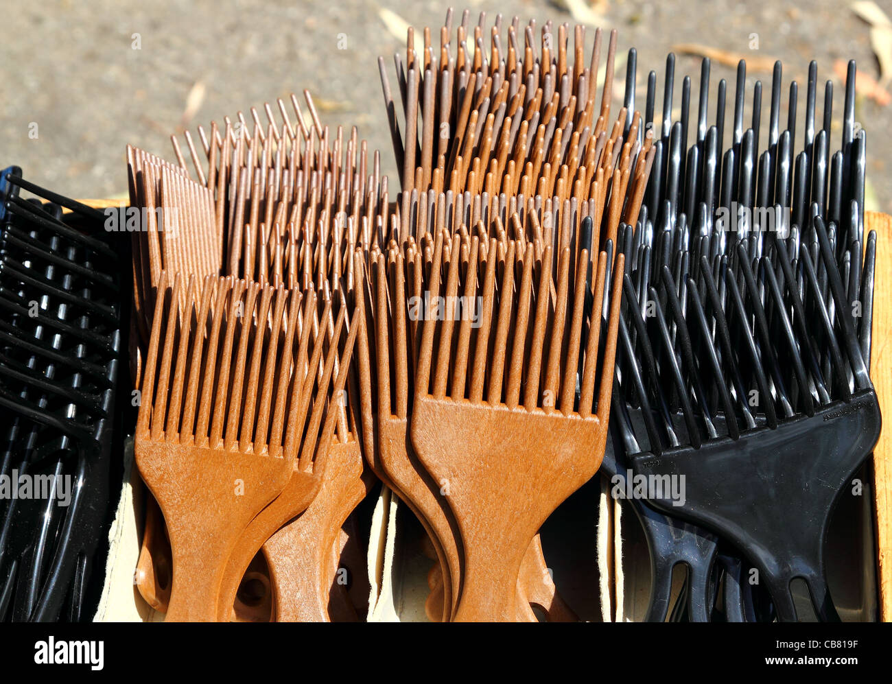 Brown black comb for long hair in outdoor market - Stock Image