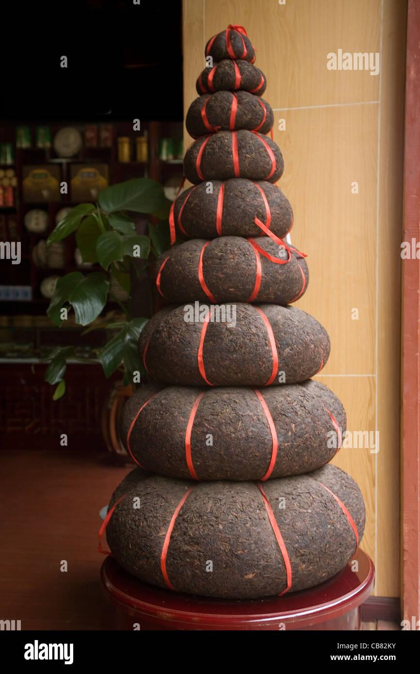 China Yunnan Lijiang Pyramid of tea cakes - Stock Image