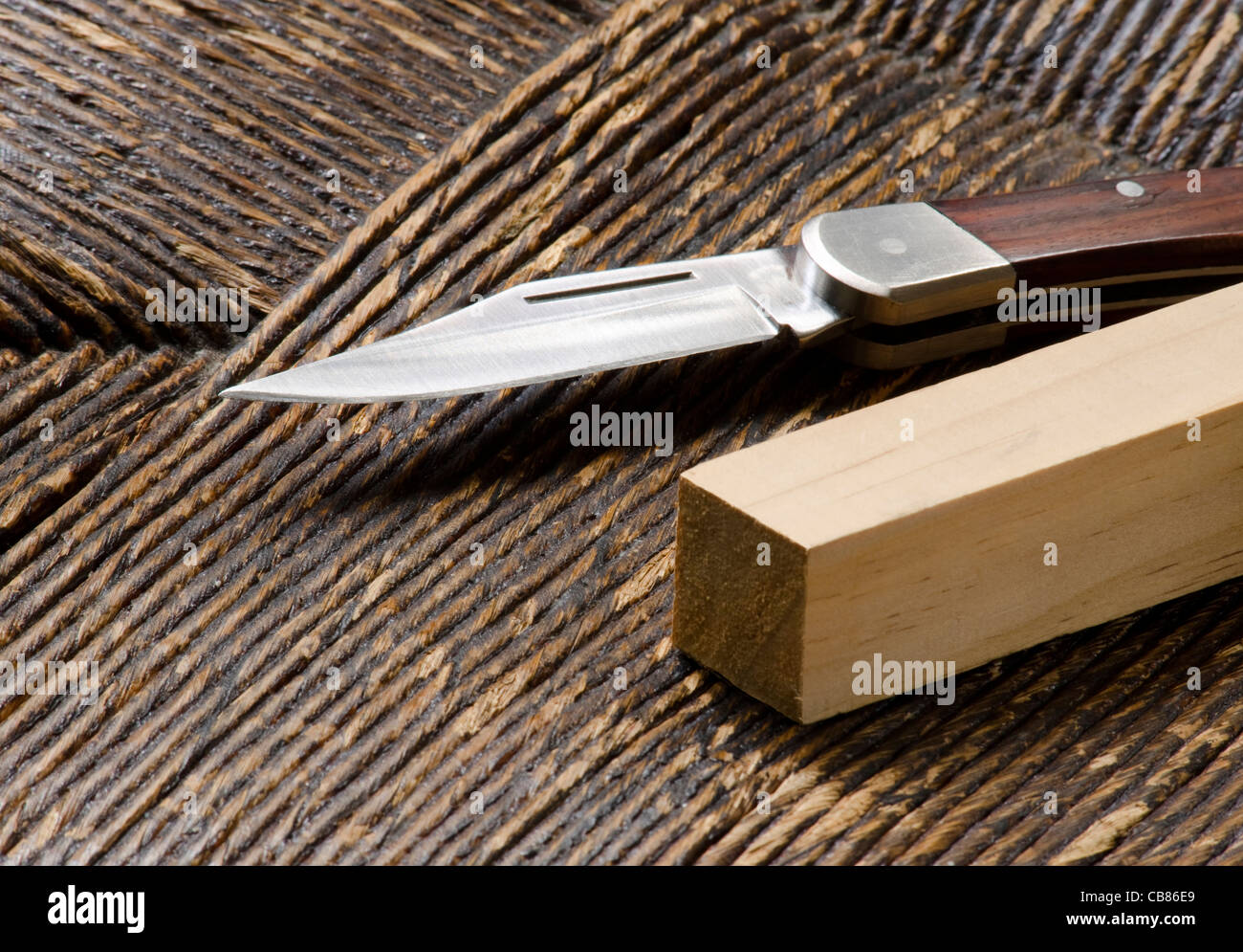 pocket knife with square wooden peg - Stock Image