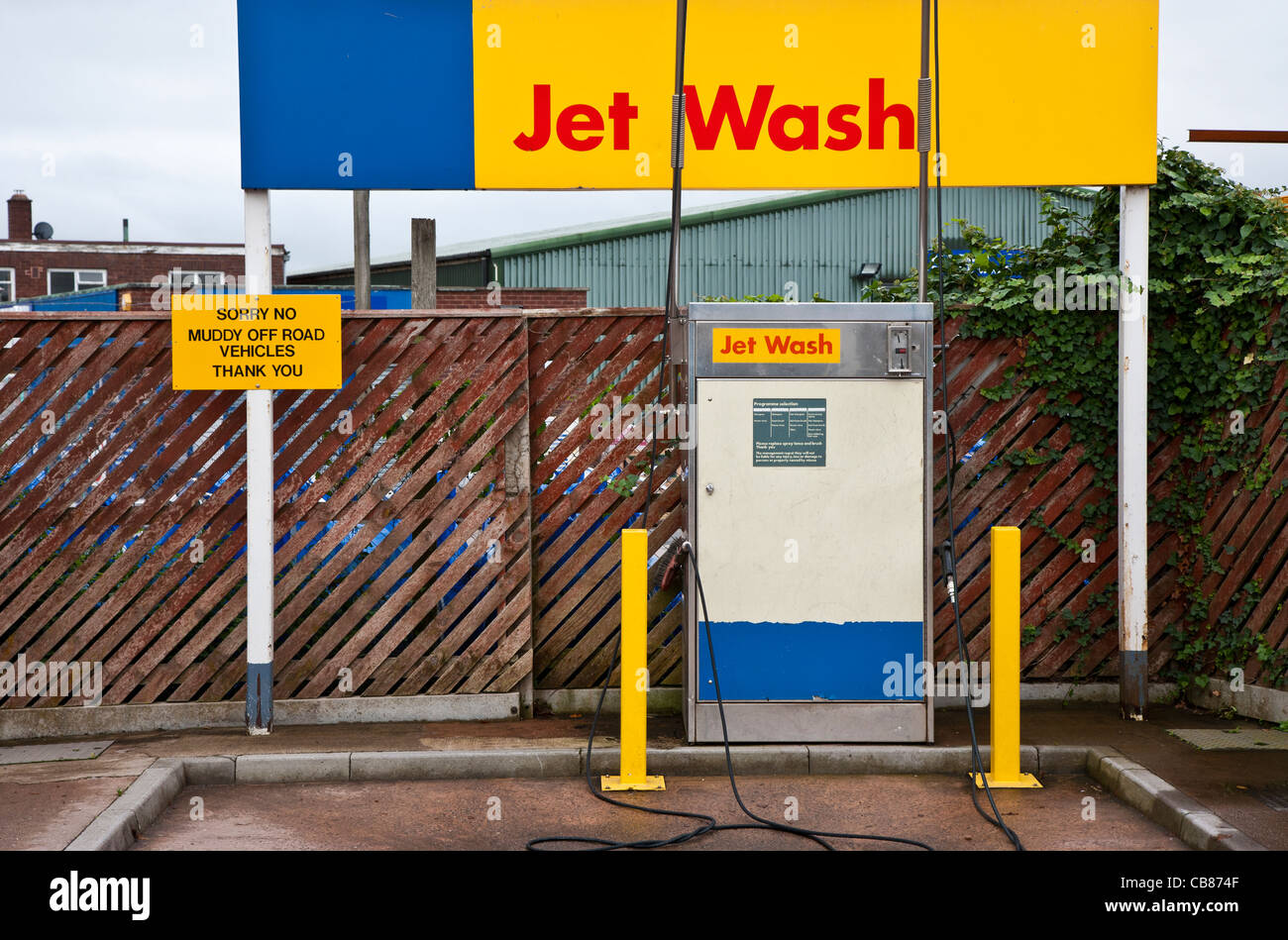 Jet car wash with sign saying no muddy off road vehicles, Devon, England - Stock Image