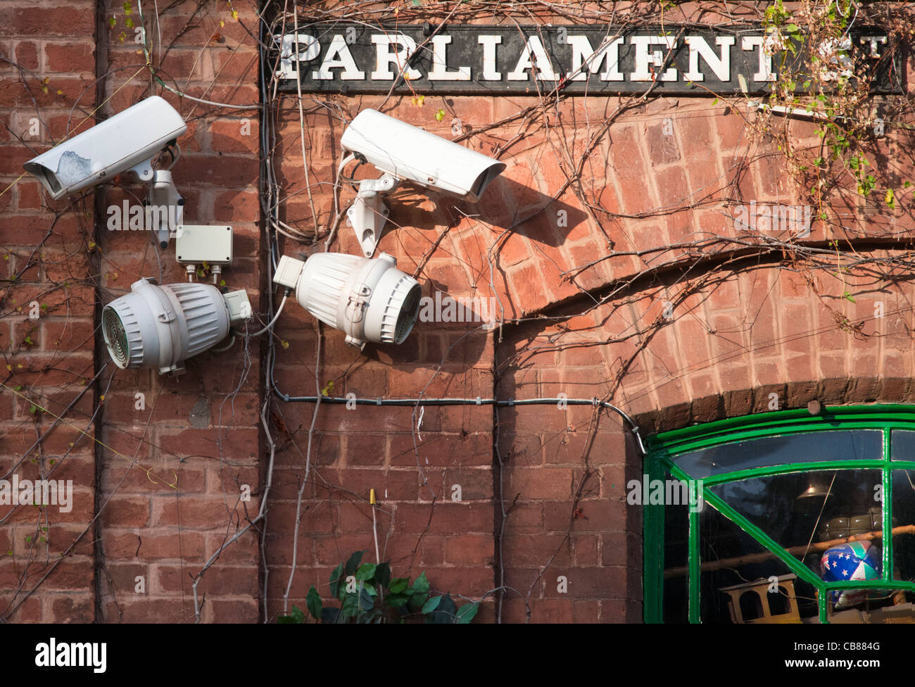 CCTV cameras and ironic street sign -Parliament Street - in Crediton, Devon, England - Stock Image