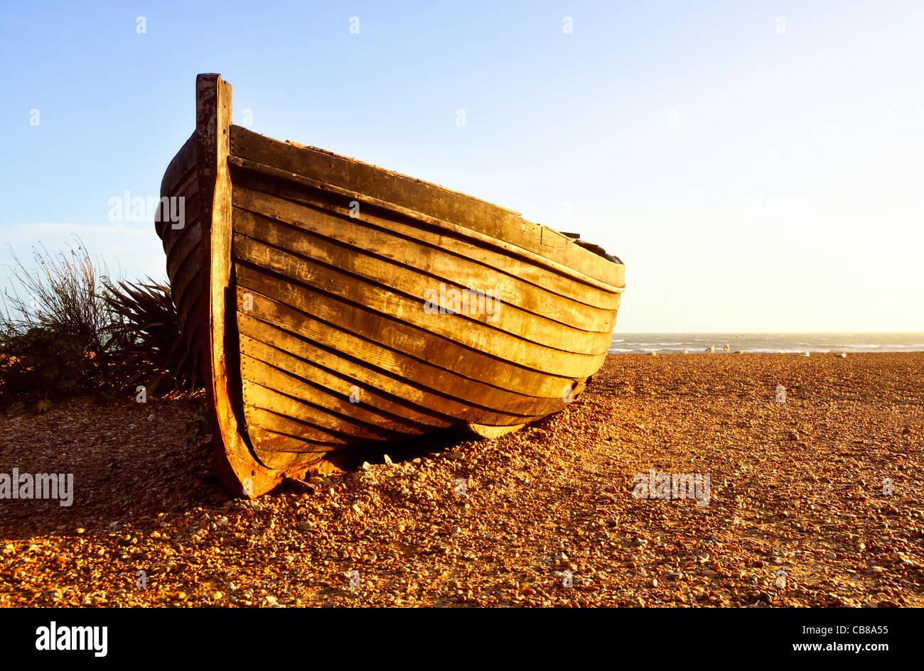 Fisherman barque at sunset on Brighton beach, UK - Stock Image
