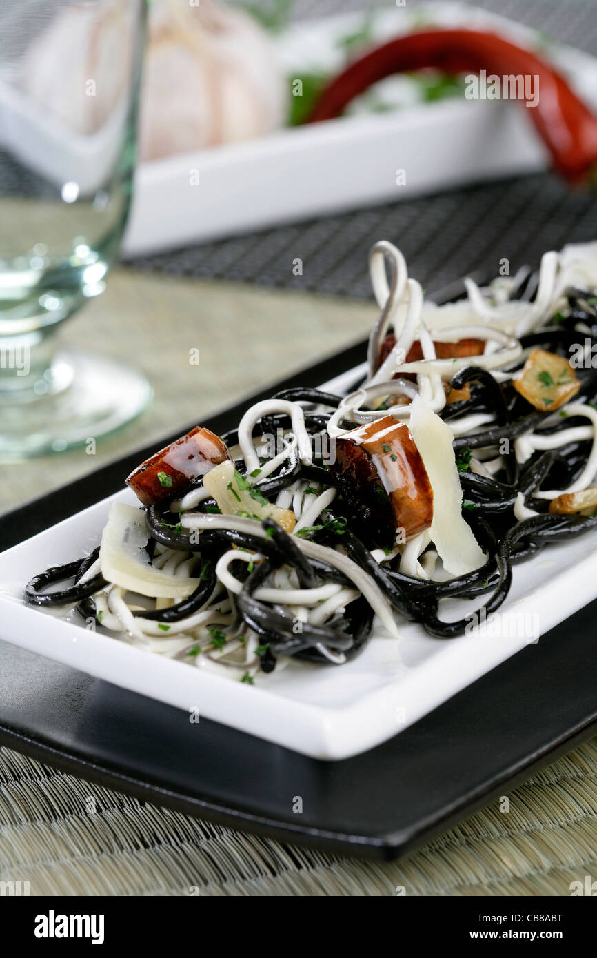 Black spaghetti with elver substitute and parmesan - Stock Image