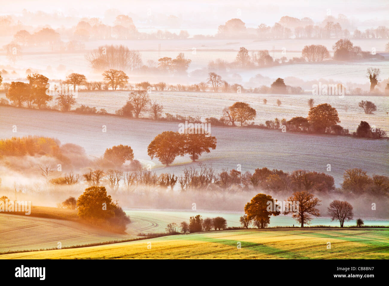 A winter sunrise view from Martinsell Hill over the Vale of Pewsey in Wiltshire, England, UK Stock Photo