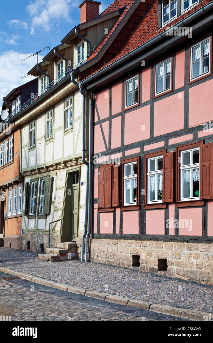 A row of half-timbered medieval houses in a cobbled street in the UNESCO World Heritage town of Quedlinburg, Germany. - Stock Image