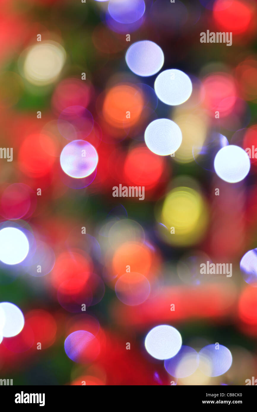 Photo of the lights from a Christmas tree deliberately taken out of focus for use as a colourful background. - Stock Image