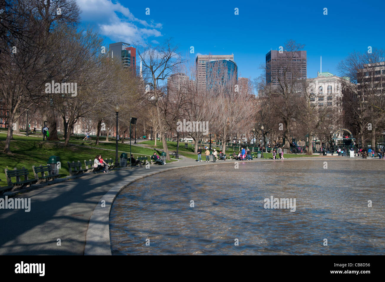 The Boston Common Frog Pond and people walking in springtime Stock Photo