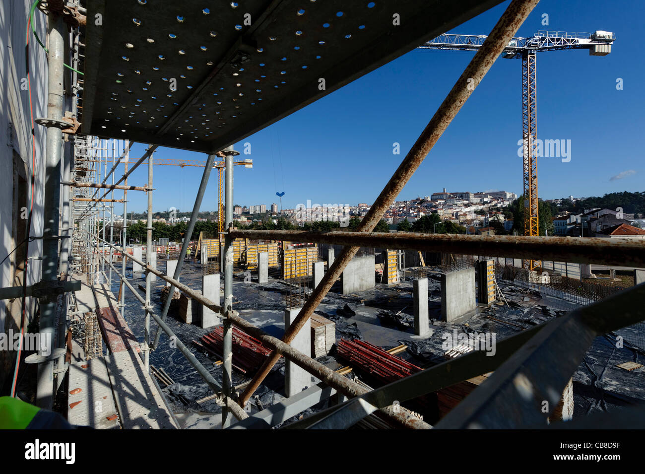 Construction site with scaffolding and cranes - Stock Image