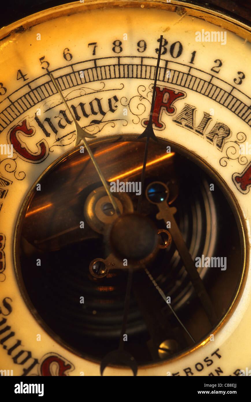 barometer needle pointing to change forecast - Stock Image